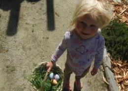Skye holding her Easter egg basket