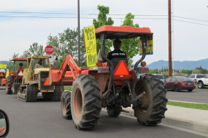 The brigade of tractors cruisin down the boulevard in downtown Medford being met with cheers and honks.