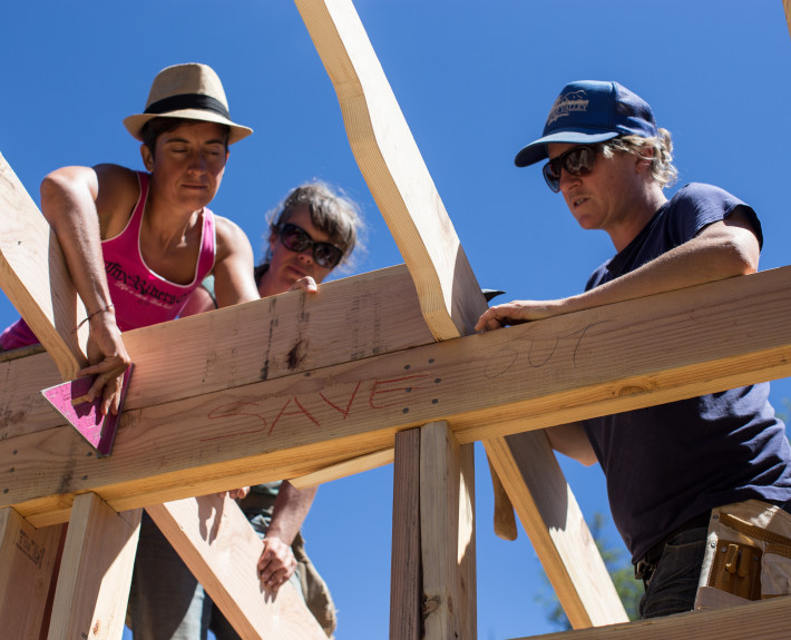 Women working during the Flying Hammer Straw bale building workshop